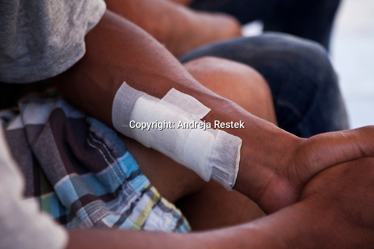 Lampedusa, some immigrants escaped from reception center trying to have some moment of freedom, showing the conditions of their trip from Libia and of their staying in the immigration center , wounded during the crossing