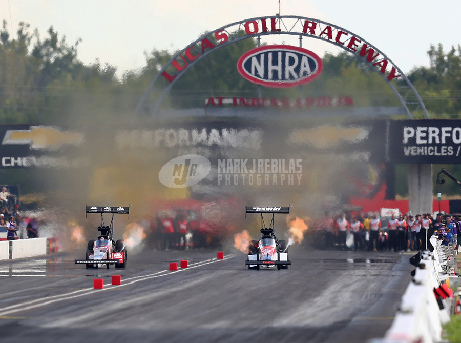 Sep 2, 2018; Clermont, IN, USA; NHRA top fuel driver Doug Kalitta (left) races alongside Blake Alexander during qualifying for the US Nationals at Lucas Oil Raceway. Mandatory Credit: Mark J. Rebilas-USA TODAY Sports