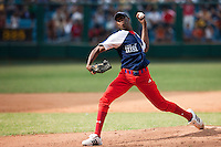 15 February 2009: Left pitcher Aroldis Chapman of the Orientales pitches during a training game of Cuba Baseball Team for the World Baseball Classic 2009. The national team is pitted against itself, divided in two teams called the Occidentales and the Orientales. The Orientales win 12-8, at the Latinoamericano stadium, in la Habana, Cuba.
