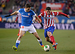 Oscar de Marcos (L) vies with Atletico Madrid's Uruguayan midfielder Cristian Rodriguez during the Spanish Copa del Rey (King's Cup) football match Atletico de Madrid vs Athletic de Bilbao at the Vicente Calderon stadium in Madrid on January 23, 2014.   PHOTOCALL3000/ DP
