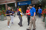 DePaul President A. Gabriel Esteban, Ph.D., greets Resident Advisor Aisha Bashir during a tour of Move In Day.  Photo by Diane M. Smutny