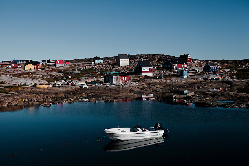 A fibreglass fishing boat lies moored in the harbor at Rodebay, West Greenland, August 2011. Photo: Ed Giles.