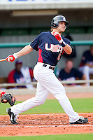 Brett Jackson #6 of the United States World Cup/Pan Am Team follows through on his swing against Team Canada at the USA Baseball National Training Center on September 28, 2011 in Cary, North Carolina.  (Brian Westerholt / Four Seam Images)