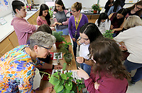 NWA Democrat-Gazette/DAVID GOTTSCHALK Ruth Teague (left), a volunteer with Botanical Garden of the Ozarks' Education and Outreach, discusses Friday, May 10, 2019, host plantsduring Animal Club at Southwest Junior High School in Springdale. Representatives with the Botanical Garden of the Ozarks' Education and Outreach visited the club to discuss caterpillars, host plants, eggs and the chrysalis for butterflies.