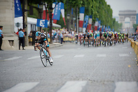 Richie Porte (AUS/SKY) showing himself as he tries to outrun the peloton<br /> <br /> 2014 Tour de France<br /> stage 21: Evry - Paris Champs-Elysées (137km)