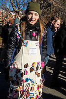 New York, USA 17 February 2017 - Activists rallied in Washington Square, in solidary with the  General Strike, to protest Trump Administration and their anti-democratic policies.  Woman selling Vag Badges, hand made brooches to rememble a woman's vagina. ©Stacy Walsh Rosenstock/Alamy