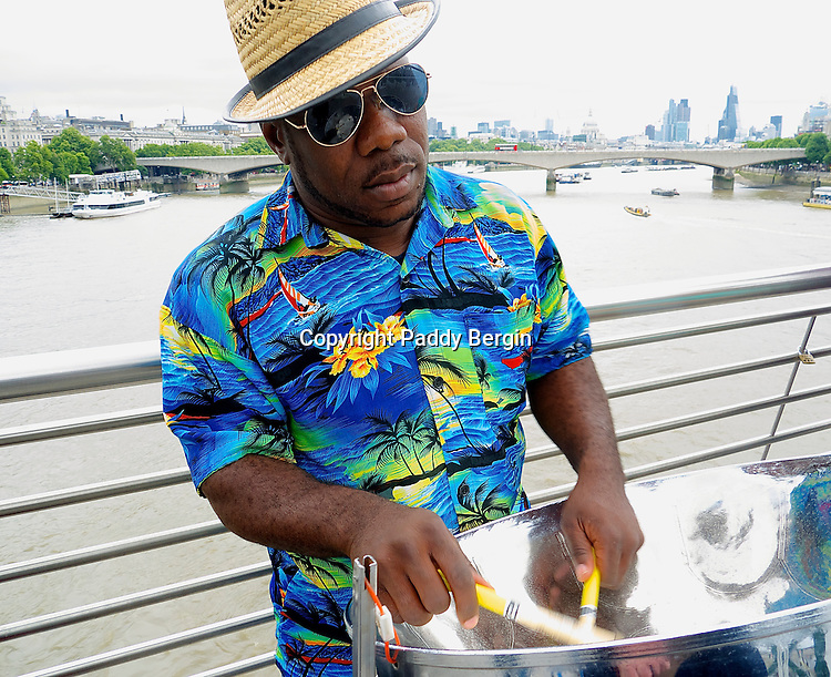 Steelpans (also known as steel drums or pans, and sometimes, collectively with other musicians, as a steel band or orchestra) is a musical instrument originating from Trinidad and Tobago. Steel pan musicians are called pannists.<br /> <br /> Street performance or busking is the practice of performing in public places, for gratuities. In many countries the rewards are generally in the form of money but other gratuities such as food, drink or gifts may be given. Street performance is practiced all over the world by men, women and children and dates back to antiquity. In English-speaking countries people engaging in this practice are called street performers or buskers.<br /> <br /> The term &quot;busking&quot; was first noted in the English language around the middle 1860s in Great Britain.<br /> <br /> The verb &quot;to busk&quot;, from the word &quot;busker&quot;, comes from the Spanish root word &quot;buscar&quot;, meaning &quot;to seek&quot; &ndash; as buskers are seeking fame and fortune.<br /> <br /> Performances can be just about anything that people find entertaining.<br /> <br /> Stock Photo by Paddy Bergin