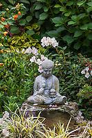 Stone Buddha statue focal point in Schneck Garden