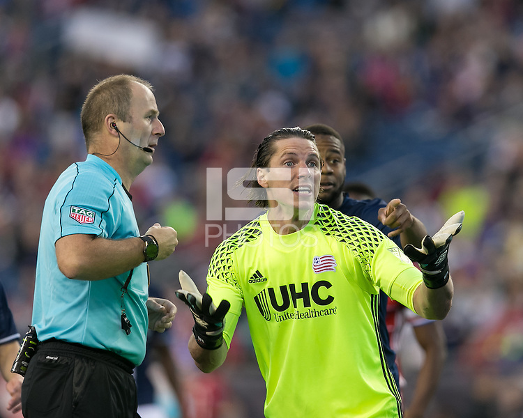 Foxborough, Massachusetts - May 21, 2016: First half action. In a Major League Soccer (MLS) match, the New England Revolution (blue/white) vs FC Dallas (red), 2-2 (halftime), at Gillette Stadium.<br /> Bobby Shuttleworth pleads case attempting to avoid yellow card and penalty kick.