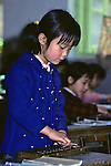 Little Girl With Abacus At School