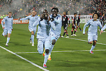 10 March 2012: Kansas City's C.J. Sapong (center) celebrates scoring the game's only goal with Kei Kamara (SLE) (23). Aurelien Collin (FRA) (78), Jacob Peterson (left), and Roger Espinoza (HON) (right) join the chase. Sporting Kansas City defeated DC United 1-0 at RFK Stadium in Washington, DC in a 2012 regular season Major League Soccer game.