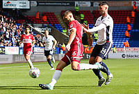 Middlesbrough's Ben Gibson shields the ball from Bolton Wanderers' Gary Madine<br /> <br /> Photographer Juel Miah/CameraSport<br /> <br /> The EFL Sky Bet Championship - Bolton Wanderers v Middlesbrough - Saturday 9th September 2017 - Macron Stadium - Bolton<br /> <br /> World Copyright &copy; 2017 CameraSport. All rights reserved. 43 Linden Ave. Countesthorpe. Leicester. England. LE8 5PG - Tel: +44 (0) 116 277 4147 - admin@camerasport.com - www.camerasport.com