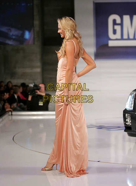 STACY KEIBLER.The 5th Annual GM Ten Fashion Show held on Vine St. in Hollywood, California, USA..February 28th, 2006.Ref: DVS.catwalk full length pink dress profile.www.capitalpictures.com.sales@capitalpictures.com.Supplied By Capital PIctures