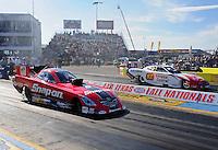 Sept. 24, 2011; Ennis, TX, USA: NHRA funny car driver Cruz Pedregon (near lane) races alongside Johnny Gray during qualifying for the Fall Nationals at the Texas Motorplex. Mandatory Credit: Mark J. Rebilas-