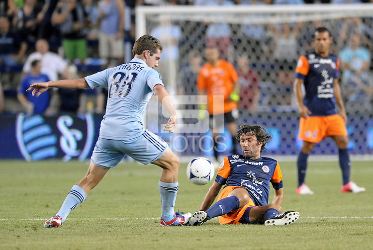 Michael Thomas (88) midfield Sporting KC, Romain Pitau (14) midfield Montpellier ..Sporting Kansas City were defeated 3-0 by Montpellier HSC in an international friendly at LIVESTRONG Sporting Park, Kansas City, KS..