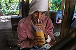 "November 10, 2014. ""Water it´s the real thing""<br /> Ernesto Montes drinks from a bottle in his house in Nejapa (El Salvador). He has the illnes of Chikungunya and he doesn' t have drinking water at home. The people of Nejapa in El Salvador, have no drinking water because the Coca -Cola company overexploited the aquifer in the area, the most important source of water in this Central American country. This means that the population has to walk for hours to get water from wells and rivers. The problem is that these rivers and wells are contaminated by discharges that makes Coca- Cola and other factories that are installed in the area. The problem can increase: Coca Cola company has expansion plans, something that communities and NGOs want to stop. To make a liter of Coca Cola are needed 2,4 liters of water. ©Calamar2/ Pedro ARMESTRE"