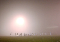Liberty and Harrisonburg high schools compete in a playoff game in extreme fog in Bealeton, VA.