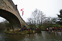 01/01/17<br /> <br /> Oscar Kirkpatrick jumps with an umbrella.<br /> New Year's Day revellers jump off Mappleton Bridge into the river below near Ashbourne in the Derbyshire Peak District. Donations were made for a local boy who was recently diagnosed with cancer. <br /> <br /> All Rights Reserved F Stop Press Ltd. (0)1773 550665   www.fstoppress.com