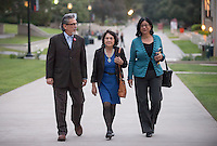 Longtime labor leader Dolores Huerta, 81, walks toward Thorne Hall flanked by Paula Crisostomo, assistant dean for Intercultural Affairs and director of the Intercultural Community Center, right, and Hugo Romo (Paula's husband) before speaking on the Occidental College campus on March 25, 2014.<br /> (Photo by Marc Campos, Occidental College Photographer)