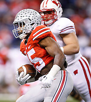 Ohio State Buckeyes running back Ezekiel Elliott (15) runs the ball in the third quarter of the Big Ten Championship game between the Ohio State Buckeyes and the Wisconsin Badgers at Lucas Oil Stadium in Indianapolis, Saturday night, December 6, 2014. As of half time the Ohio State Buckeyes led the Wisconsin Badgers 38 - 0. (The Columbus Dispatch / Kyle Robertson)