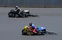 Jul, 21, 2012; Morrison, CO, USA: NHRA pro stock motorcycle rider Scott Pollacheck (near lane) alongside Matt Guidera during qualifying for the Mile High Nationals at Bandimere Speedway. Mandatory Credit: Mark J. Rebilas-
