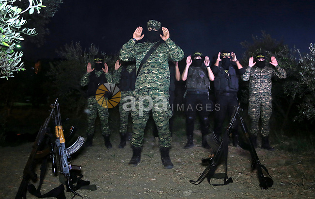 Palestinian militants from the Al-Quds Brigades, the armed wing of the Islamic Jihad movement perform prayer as they guard the border between the Gaza Strip and Israel on the Muslim holy fasting month of Ramadan on June 17, 2017. Ramadan is sacred to Muslims because it is during that month that tradition says the Koran was revealed to the Prophet Mohammed. The fast is one of the five main religious obligations under Islam. More than 1.5 billion Muslims around the world will mark the month, during which believers abstain from eating, drinking, smoking and having sex from dawn until sunset. Photo by Dawod Abo Elkass