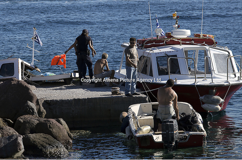 Pictured: Coastguard and other emergency services in Aegina. Tuesday 16 August 2016<br />