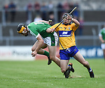 Brian Ryan of Limerick in action against Pauric Mc Namara of Clare during their Munster U-21 hurling quarter final at Cusack park. Photograph by John Kelly.