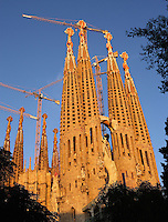 Apse exterior, neo gothic style, one of the first elements to be built by the initial architect Francisco de Villar and respected by Gaudí; Nativity façade?s bell towers; Passion façade, completed late 1980?s by the sculptor Josep Maria Subirachs, La Sagrada Familia, Barcelona, Catalonia, Spain, Roman Catholic basilica, built by Antoni Gaudí (Reus 1852 ? Barcelona 1926) from 1883 to his death. Still incomplete Picture by Manuel Cohen