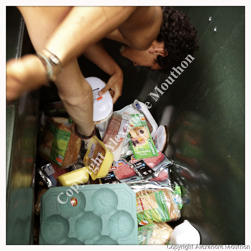 In France, during summer holidays, a family is going every day into supermarket garbages in order to show the waste of edible food.
