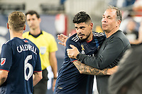 FOXBOROUGH, MA - SEPTEMBER 29: Bruce Arena of New England Revolution congratulates Gustavo Bao #7 of New England Revolution for his game during a game between New York City FC and New England Revolution at Gillettes Stadium on September 29, 2019 in Foxborough, Massachusetts.