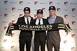 PHILADELPHIA, PA - JANUARY 19: Joao Moutinho (POR) (left) was taken with the first overall pick and Tristan Blackmon (right) was selected third by Los Angeles Football Club. With head coach Bob Bradley (center). The MLS SuperDraft 2018 presented by adidas was held on January 19, 2018 at the Pennsylvania Convention Center in Philadelphia, PA.