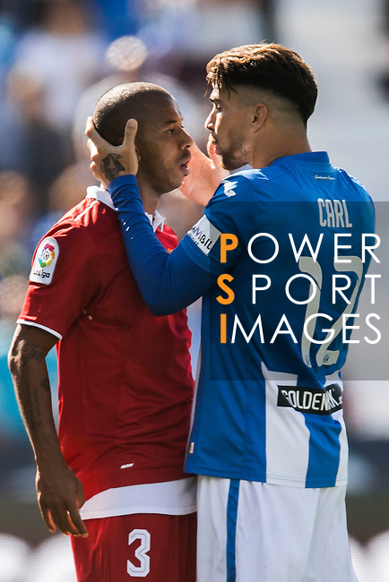 Mariano Ferreira Filho of Sevilla FC clashes with Carl Medjani of Deportivo Leganes as Ruben Perez of Deportivo Leganes is injured during their La Liga match between Deportivo Leganes and Sevilla FC at the Butarque Municipal Stadium on 15 October 2016 in Madrid, Spain. Photo by Diego Gonzalez Souto / Power Sport Images