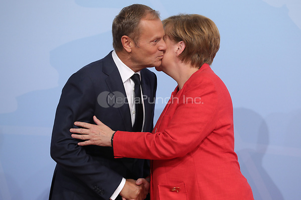 German chancellor Angela Merkel greets Donald Tusk, the the president of the European Council, at the G20 summit in Hamburg, Germany, 7 July 2017. The heads of the governments of the G20 group of countries are meeting in Hamburg on the 7-8 July 2017. Photo: Michael Kappeler/dpa /MediaPunch ***FOR USA ONLY***