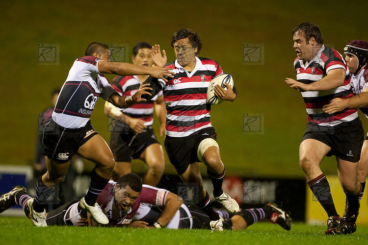 Tim Nanai Williams looks to fend off the North Harbour tackler. Counties Manukau Steelers pre season ITM Cup game against North Harbour played at Bayer Growers Stadium Pukekohe on Wednesday July 21st 2010..North Harbour won 22 - 21.