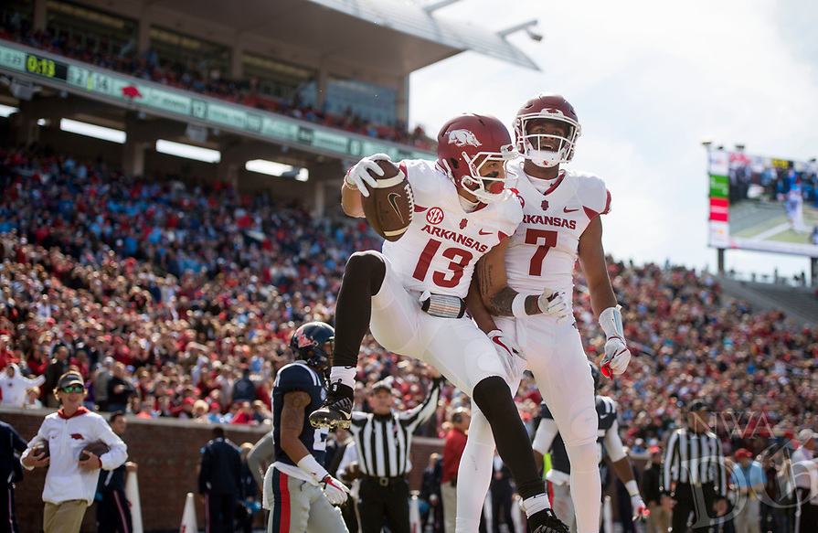 Hawgs Illustrated/BEN GOFF <br /> Deon Stewart (13) and Jonathan Nance (7), Arkansas wide receivers, celebrate after Stewart scored in the second quarter against Ole Miss Saturday, Oct. 28, 2017, at Vaught-Hemingway Stadium in Oxford, Miss.