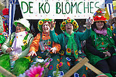 2 March 2014, Duesseldorf, Germany. Pictured: women dressed as flowers. Costumed carnival-goers enjoy the sunshine as they celebrate with a street party in Duesseldorf, North Rhine-Westphalia, Germany.