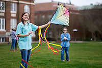 Kite flying on Drill Field: MSU student Samantha Clark with child Jenna Holder.<br />  (photo by Megan Bean / &copy; Mississippi State University)