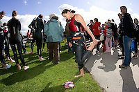 20 JUL 2008 - MANLEY, UK - A competitor stretches during the race briefing - Deva Divas Triathlon. (PHOTO (C) NIGEL FARROW)
