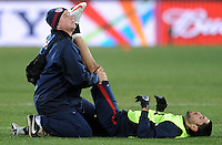 Clint Dempsey of USA receives treatment from a physio during training at Ellis Park, Johannesburg on June 27, 2009 in preparation for the FIFA Confederations Cup Final against Brazil.
