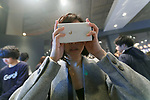 A visitor tries out a Google VR (virtual reality) glasses during the Slush Tokyo 2017 event on March 29, 2017, Tokyo, Japan. The 2 day event features outstanding entrepreneurs sharing their stories and showcasing their products and services in Tokyo Big Sight. (Photo by Rodrigo Reyes Marin/AFLO)
