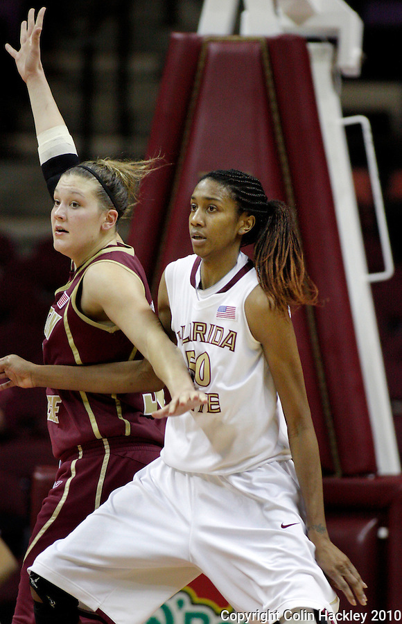 TALLAHASSEE, FL 1/24/10-FSU-B.C WBB10 CH04-Florida State's Jacinta Monroe, right, works in the lane against Boston College's Stefanie Murphy during action Sunday at the Donald L. Tucker Center in Tallahassee. ..COLIN HACKLEY PHOTO