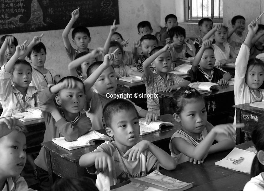 Children in class at the Danzhou Shi Yan Primary school, Danzhou City, Hainan Island, China. Danzhou city has the highest gender inbalance in China with 170 males born for every 100 females according to figures from Chinese Government 5t National Census. The inbalance is already having a massive social impact on society and is expected to get worse while the ruthless One Child Policy, aimed at curbingChina's 1.3 billion population, continues to be law.<br /> 25 Apr 2007<br /> <br /> photo by Richard Jones / Sinopix