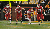 NWA Media/Michael Woods --11/28/2014-- w @NWAMICHAELW...University of Arkansas punter Sam Irwin-Hill (92) runs the ball for a first down on a fake punt in the 3rd quarter of Friday afternoons game against Missouri at Faurot Field in Columbia Missouri.