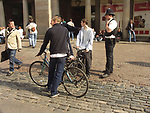 A51PC7 Police talking to youth Covent Garden London England
