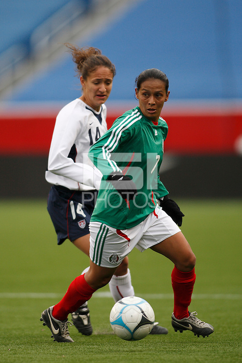 Mexico midfielder (7) Evelyn Lopez is trailed by USA defender (14) Stephanie Lopez. The USA Women's National Team defeated Mexico 5-0 in an international friendly at Gillette Stadium, Foxbourgh, MA, on April 14, 2007.