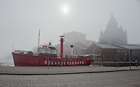 Relandersgrund lightship is docked at Helsinki harbour and is shrouded in fog.