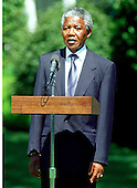 Washington, D.C. - June 25, 1990 -- Nelson Mandela, leader of the African National Congress (ANC) makes remarks as he is welcomed by United States President George H.W. Bush to the White House for talks on Monday, June 25, 1990.  .Credit: Ron Sachs / CNP
