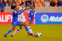 HOUSTON, TX - JANUARY 28: Lynn Williams #13 of the United States and Ruthny Mathurin #10 of Haiti battle for ball in an Olympic Qualifying match during a game between Haiti and USWNT at BBVA Stadium on January 28, 2020 in Houston, Texas.