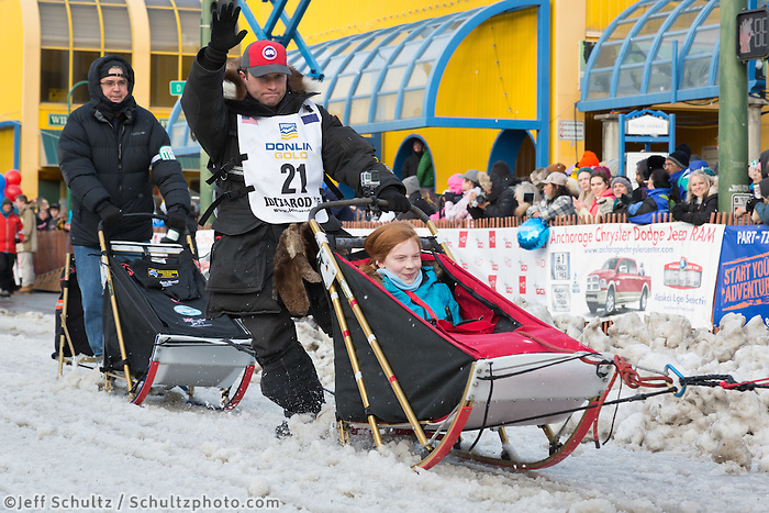 Curt Perano and team leave the ceremonial start line with an Iditarider at 4th Avenue and D street in downtown Anchorage, Alaska during the 2015 Iditarod race. Photo by Jim Kohl/IditarodPhotos.com